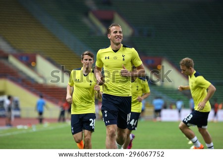 May 27, 2015 - Shah Alam, Malaysia: Tottenham Hotspur's top striker Harry Kane (18) jogs to warm up on the pitch before a friendly match. Tottenham Hotspur is on a Asia-Australia tour. - stock photo