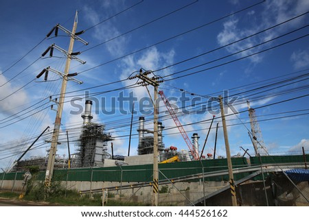 MAY 22, 2015: SRIRACHA, THAILAND. View of new construction of electrical power switch-gear and power plant in area of oil refinery plant on bright blue sky and a sunny day.