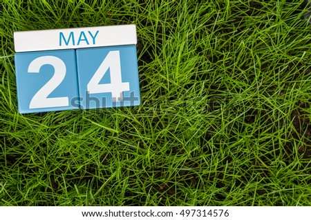May 24th. Day 24 of month, calendar on football green grass background. Spring time, empty space for text