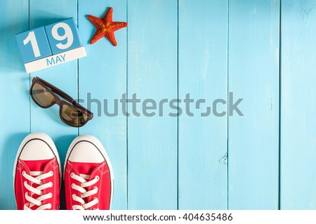 May 19th. Image of may 19 wooden color calendar on blue background.  Spring day, empty space for text - stock photo
