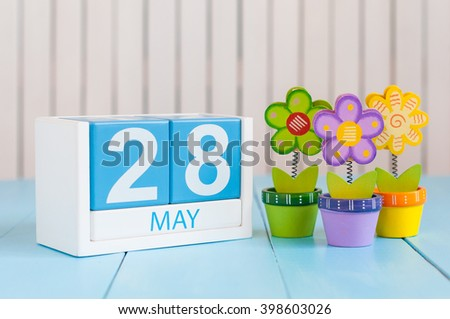 May 28th. Image of may 28 wooden color calendar on white background with flowers. Spring day, empty space for text - stock photo