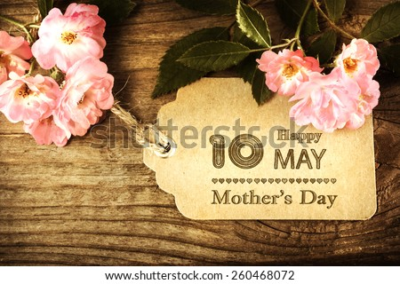 May 10th Mothers Day card with small roses on wood background - stock photo