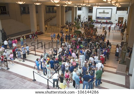 MAY 2009 - Tourists stand in line for tickets with view of U.S. Capitol through glass windows at the U.S. Capitol Visitors Center, Washington, D.C. - stock photo