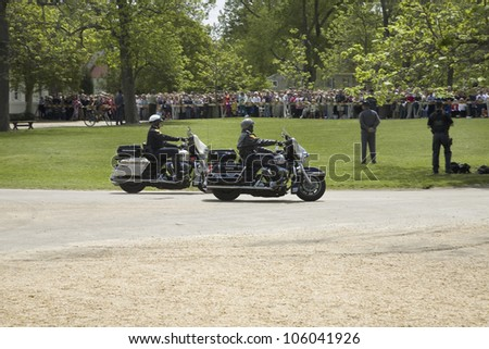 MAY 2007 - Two motorcycle policemen arriving in front of Governor's Palace in Williamsburg, Virginia in anticipation of arrival of Her Majesty Queen Elizabeth II - stock photo