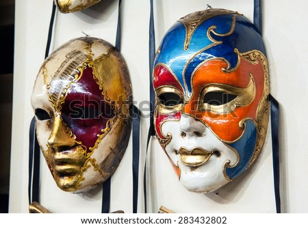 May 15, 2015 -Venice, Veneto, Italy : Close up view of two venetian carnival masks hanging on a wall
