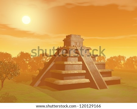 Maya pyramid on green grass and surrounded with trees by sunset foggy weather - stock photo