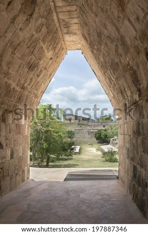 Mayan Arch in Uxmal, Mexico This image is taken from within an arch that leads to the Governor´s palace in Uxmal in Yucatan, Mexico  - stock photo
