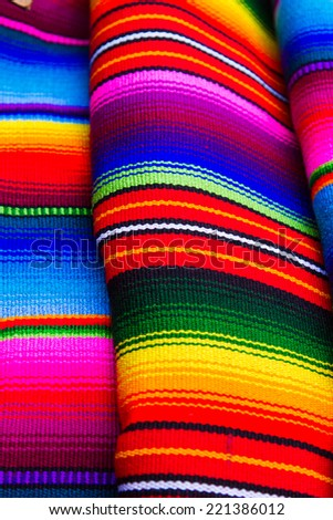Mayan blankets textile designs on the market in Chichicastenango, Guatemala - stock photo