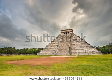 Mayan Chichen Itza pyramid with dramatic cloudy sky in Mexico - stock photo