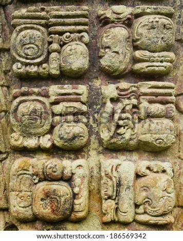 Mayan hieroglyphic writing icons in a stone stalae in Copan, Honduras - stock photo