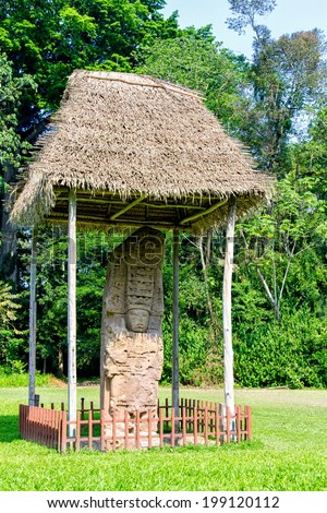 Mayan hieroglyphs and faces on stelae in Quirigua archeological site, Guatemala, Central America - stock photo