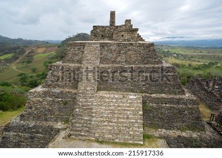 Mayan pyramid at the pre-Columbian ruins of Tonina in Chiapas, Mexico on a rainy day  - stock photo