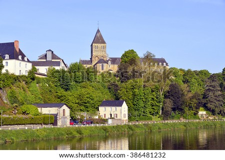 Mayenne river at Chateau-Gontier with the Saint-Jean-Baptiste church in the background, commune in the Mayenne department, Pays de la Loire Region, in north-western France - stock photo