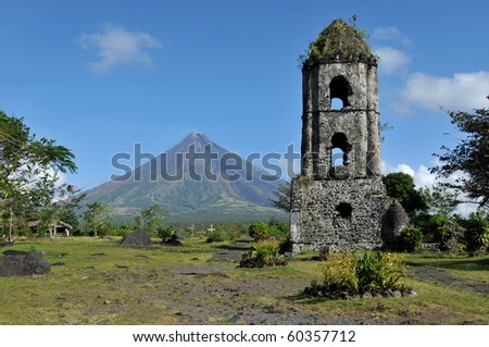Mayon Volcano and the ruins of Cagsaua Church in the Philippines.