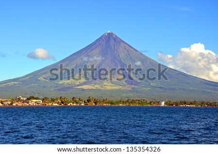 Mayon Volcano in Legazpi, Philippines. Mayon Volcano is an active volcano and rising 2462 meters from the shores of the Gulf of Albay. - stock photo
