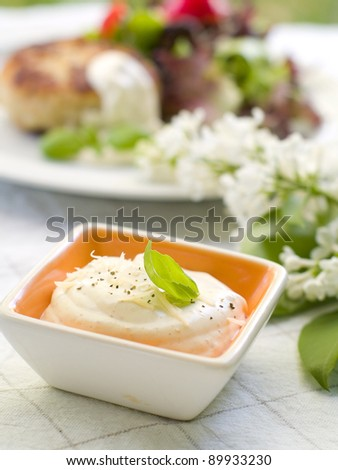 Mayonnaise sauce with shrimps in bowl, selective focus