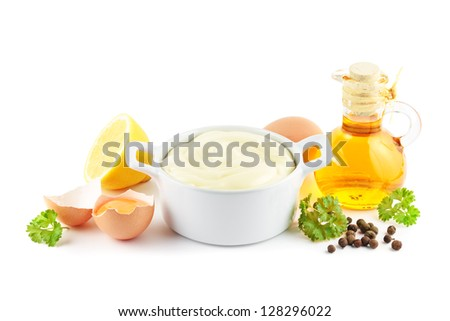 Mayonnaise with ingredients including oil, eggs, lemons and spices - stock photo