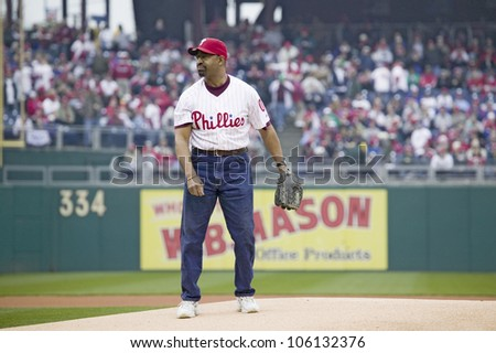 Mayor Michael Nutter throwing opening pitch of baseball game on March 31, 2008, Citizen Bank Park where 44,553 attend as the Washington Nationals defeat the Philadelphia Phillies 11 to 6. - stock photo