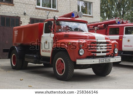 MAZSALACA, LATVIA - MARCH 6, 2015: Red ZIL 130 firetruck at the city street.  - stock photo