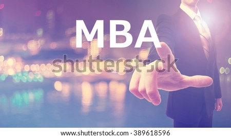 MBA concept with businessman on blurred city background   - stock photo