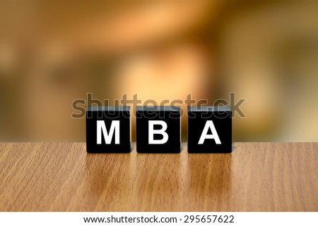 MBA or Master of Business Administration on black block with blurred background - stock photo