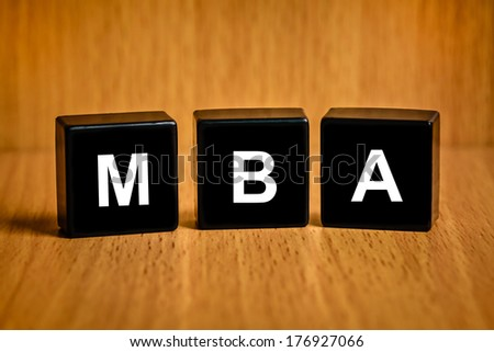 MBA or Master of Business Administration text on black block - stock photo