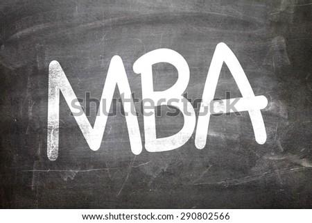 MBA written on a chalkboard - stock photo