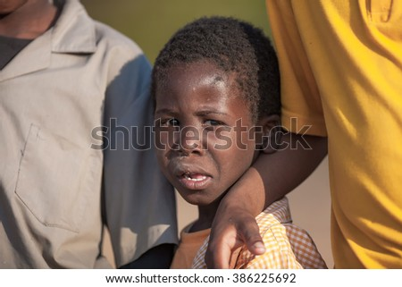 MBABANE, SWAZILAND - AUGUST 6: Unidentified orphan Swazi schoolboy in a local school on August 6, 2008 in Mbabane, Swaziland. 10 percent of Swaziland's total population are orphans, due to HIV/AIDS. - stock photo