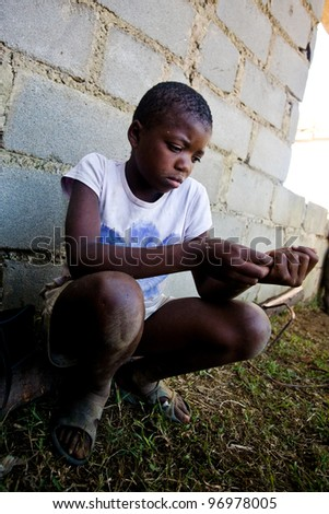 MBABANE, SWAZILAND- JULY 30: Portrait of unidentified Swazi girl on July 30, 2008 in Mbabane, Swaziland. Close to 10 percent of Swaziland's total population are orphans, due to HIV/AIDS. - stock photo
