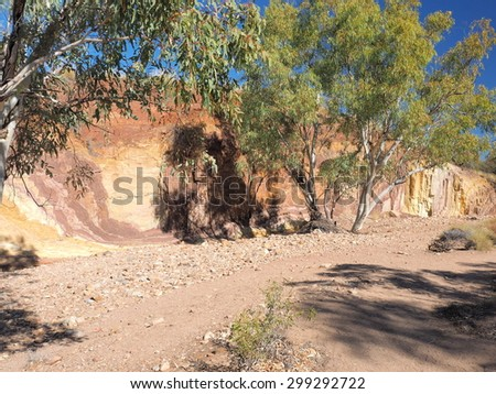 McDonnell Ranges river bed with ochre lines, place of indigenous Ochre mining, Alice Springs, Australia, July 2015 - stock photo
