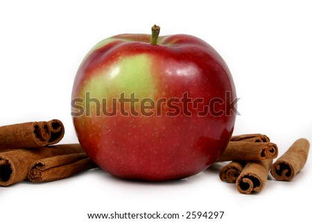 mcintosh apples and cinnamon stick isolated on white background