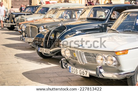 MDINA, MALTA - OCTOBER 10, 2014: vintage classic retro cars parked in San Pawl square. The ancient capital Mdina is a medieval walled town situated on a hill in the centre of the island - stock photo