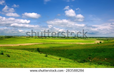 Meadow and blue sky. panoramic view.  - stock photo
