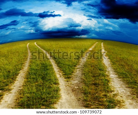 Meadow Road and cloudy. - stock photo