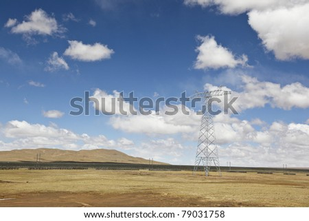 meadow with cloudscape on the altiplano in the northwest of china - stock photo