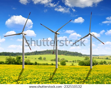 Meadow with wind turbines - stock photo