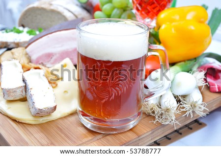 Meal concept with bread, onion, tomatoes, cheese, beer, bacon and pepper. - stock photo