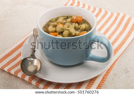 meal in a blue mug, vegetarian pea soup with carrots