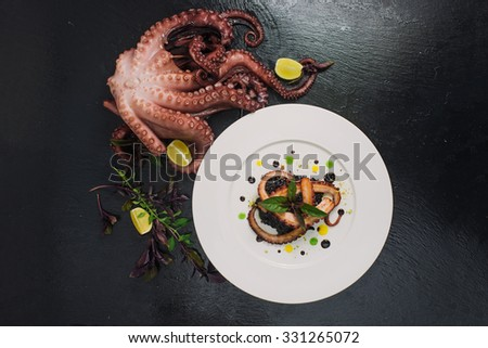 meal in the restaurant of the octopus - stock photo