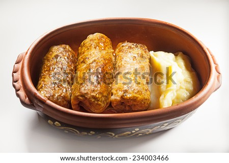 Meal portion of cabbage rolls and mashed.  - stock photo
