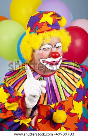 Mean angry clown shaking his finger and frowning. - stock photo
