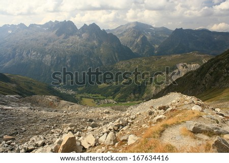 meandering footpath to glacial valley in French Alps - stock photo
