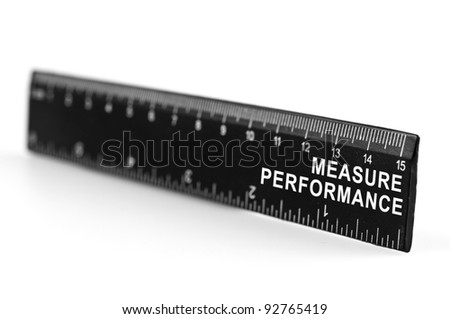Measure performance on black ruler - stock photo