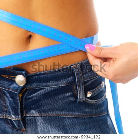 Measure tape around slim beautiful waist. - stock photo