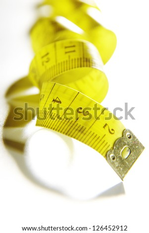 Measure tape. Isolated over white. Yellow measuring tape isolated on white background