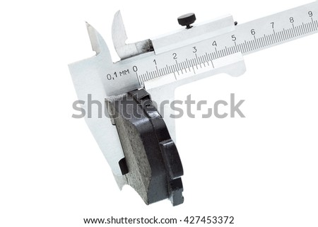 measurement by a caliper of thickness of brake pads of the car on a white background, the isolated image nobody.