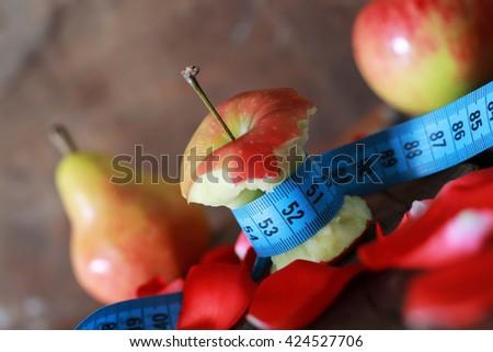 measurement red bitten apple  - stock photo