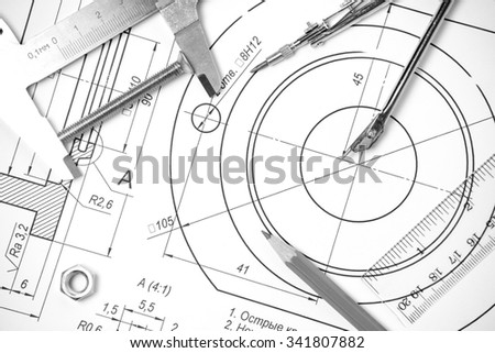 Measuring and drawing instruments and drawings on the table - stock photo