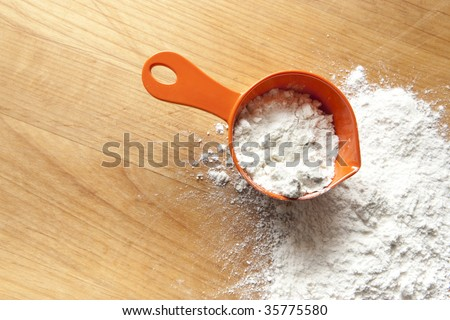 Measuring Cup with Flour - stock photo