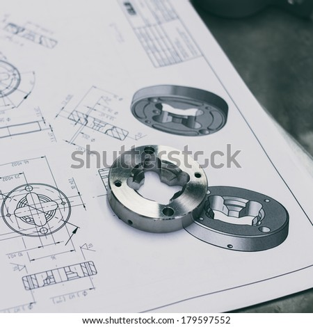 measuring metal component - stock photo